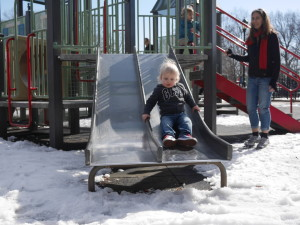 Sliding down a slide surrounded by ice.