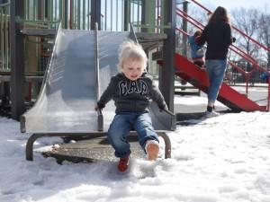 Tate had so much fun kicking the snow into the air!