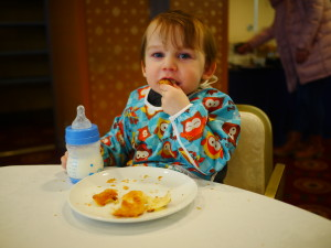 Enjoying the breakfast buffet in our hotel.  A pastry and milk!