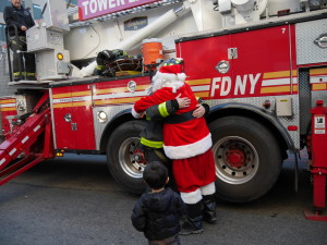 So sweet, Santa giving one of the firemen a thank you hug.